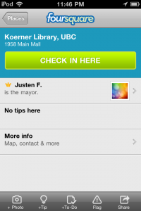 An image of an ipod screen with the foursquare social network check in for Koerner Library
