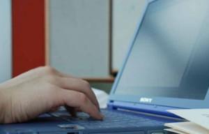 someone typing on laptop
